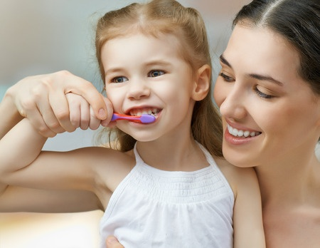 27245792 - mother and daughter brush my teeth